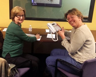 Diana Spurgin (right) and Anne Palmer answer phones during Monte's March IV.
