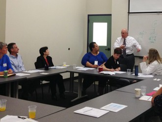 Commissioner Jeff McCue discusses the DTA with Food Bank staff during a recent visit to our Hatfield warehouse