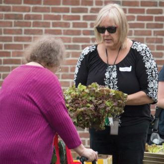 Client receives produce at a Mobile Food Bank