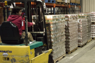 Justin unloads pallets of nutritious food donated by Big Y customers during their Sack Hunger campaign