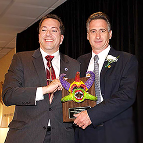 Mass. State Representative Aaron Vega (left) presents The Food Bank's Executive Director, Andrew Morehouse, with the Carlos Vega Community Champion Award.