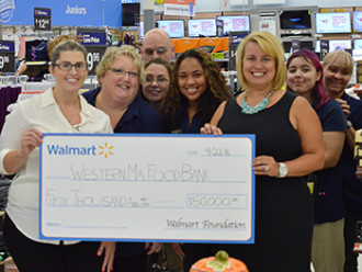Our Director of Development and Marketing, Sarah Tsitsi, was presented a check for $50,000 from The Walmart Foundation.