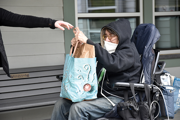 Receiving groceries at Brown Bag: Food for Elders